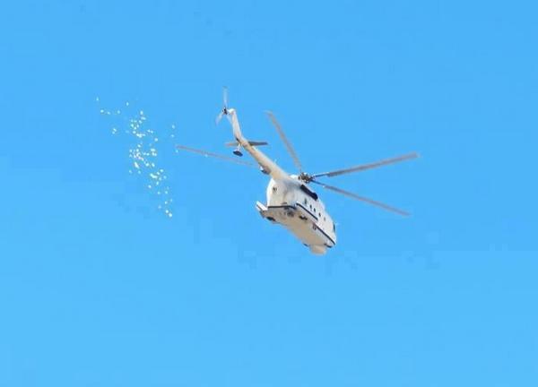 Ми-14 скидывает листовки над Бенгази