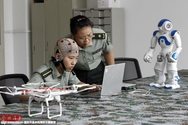 PLA working on controlling robots with brain signals 3
