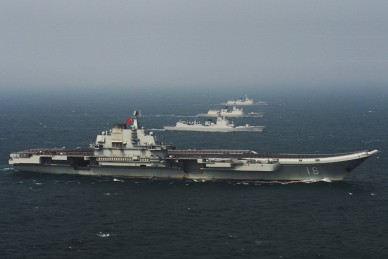 The First Chinese Carrier Strike Group Liaoning and escorts during recent South China Sea deployment