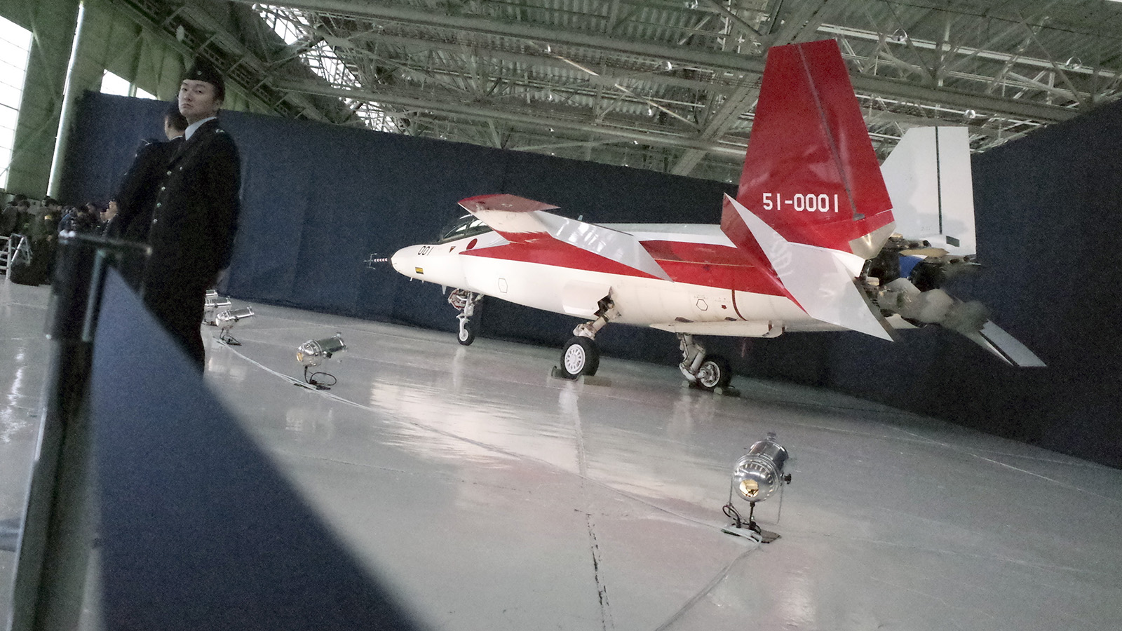 The first domestically-made stealth aircraft, X-2, sits in a hangar at Nagoya Airport in Toyoyama town, central Japan, Thursday, Jan. 28, 2016. The demonstration plane is expected to make its maiden flight sometime after mid-February. A Defense Ministry official said the technology will give Japan the option of developing its own stealth fighter jets in the future. (AP Photo/Emily Wang)
